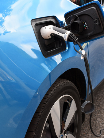 Close-up view of sockets for charging a blue electric car