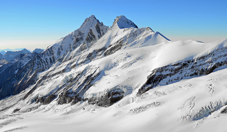 High snowy mountain peaks and glaciers rocks with blue sky, freedom Stock Photo