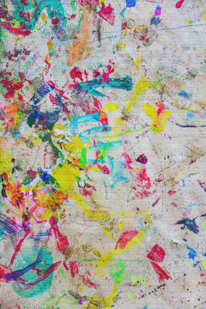 Painting canvas, remnants of paint, splashes of brushes randomly painted Imagens