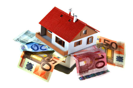 Isolated house with different european money Stock Photo