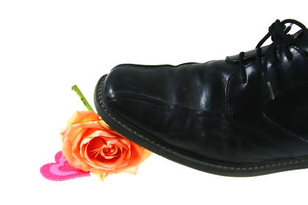 Black shoes, brocken heart and flower Stock Photo