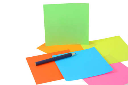 colored papers and pen isolated on white background