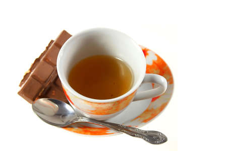 cup of tea with chocolate on white background