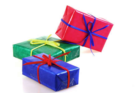 some colored gift boxes on white background