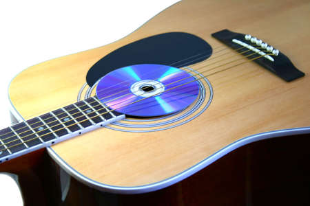 guitar with audio disc on white background Stock Photo