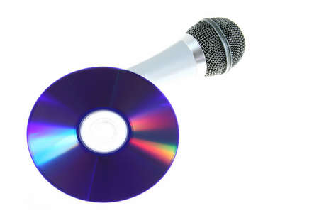 isolated microphone and blue disc as symbol for sound and music
