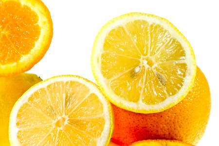 oranges and lemons on white background as sample of my isolated food objects Stock Photo
