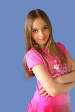 young girl in pink on blue background Stock Photo