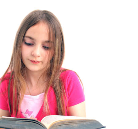 Young girl reading a book on white background, as sample for my isolated images. See other images of this model.