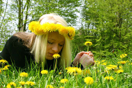 girl smelling and kissing flowers in nature Stock Photo