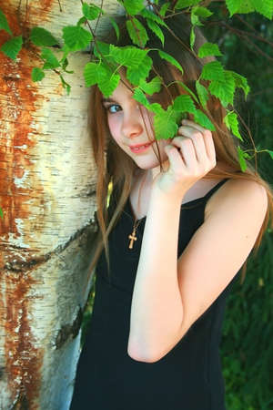 cristian: teen in nature with liitle crusafix