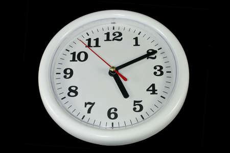 white clock on black background as sample for my isolated images Stock Photo