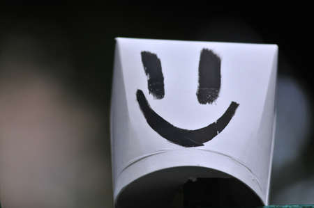 Smiley icon on paper glass Stock Photo - 16103586
