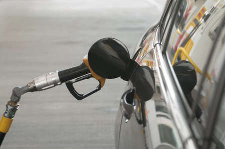 Car in gas station for fueling photo