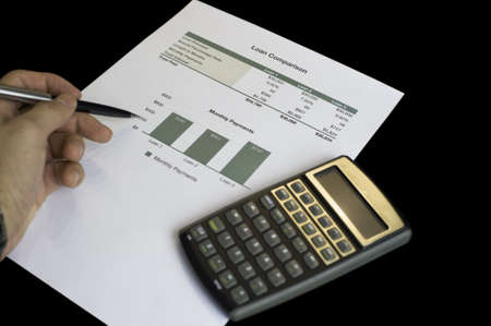 Loan comparison, data sheets, calculator and pen Stock Photo - 16553318