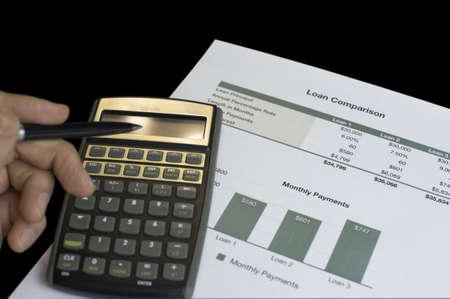 Loan comparison, data sheets, calculator and pen Stock Photo - 16553319