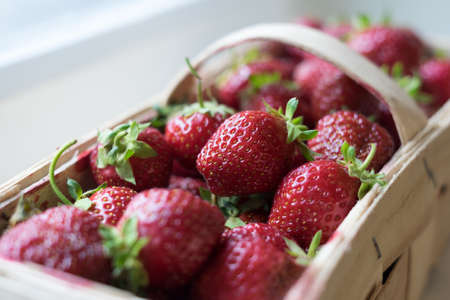 Organic Strawberries in Wooden Basket Ready For Sale Stock Photo