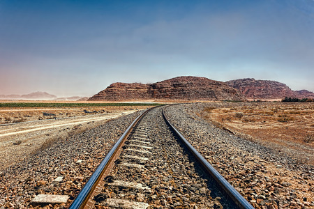 The Hejaz Railway Hicaz Demiryolu, a narrow gauge railway that ran from Damascus to Medina, through the Hejaz region of Saudi Arabia, with a branch line to Haifa on the Mediterranean Sea. It was a part of the Ottoman railway network, Wadi Rum desert, Jordan Stock Photo