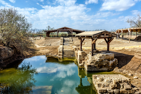 Authentic site of Jesus' baptism under blue skies with fluffy clouds
