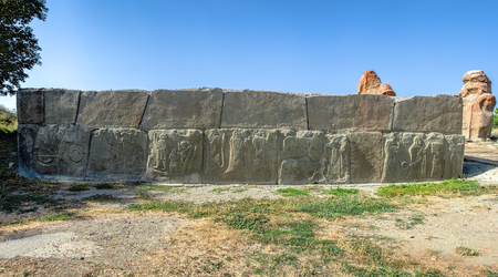 Panoramic view of the embossed terracotta wall panels in Alacahoyuk, Corum, Turkey - Hittite Civilization dating prior to 1700 BC under clear blue skies