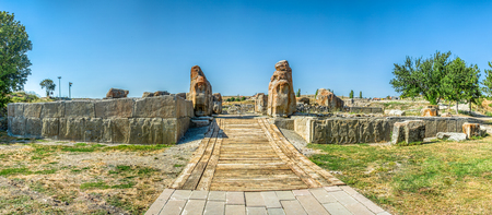 Sphinxes and Reliefs on the Southern Gate at Alacahoyuk, Corum, Turkey - Hittite Civilization dating prior to 1700 BC under clear blue skies Stock Photo