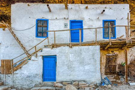 White adobe house with wooden stairs in a village, Ermenek, Anatolia, Turkey Reklamní fotografie