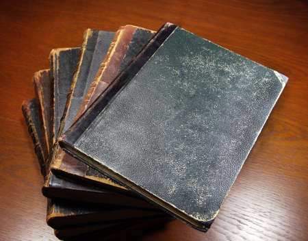 antique books: antique books on the wooden table Stock Photo