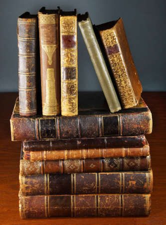 ancient books: ancient books on a wooden table Stock Photo