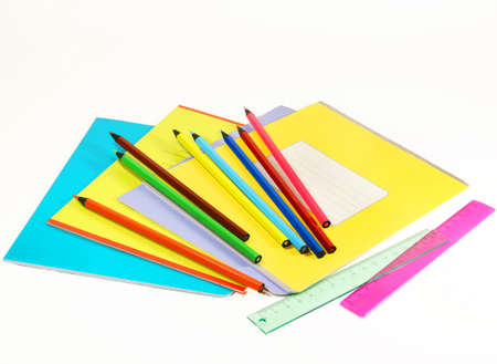 pensil: notebooks, rulers and pencils on white background isolated