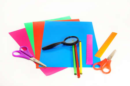 pensil: painting set and magnifier on a white background isolated