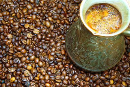 cezve: coffee in a copper cezve and coffee beans on canvas background
