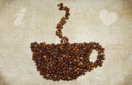 i nobody: cup-shaped pattern of coffee beans on canvas background