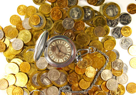 top veiw: concept ruble coins with a clock on top of a light background