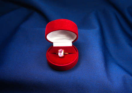 ruby ring in red box on a velvet background photo