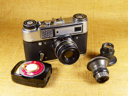 photocamera: old-fashioned photo-camera and the accessories