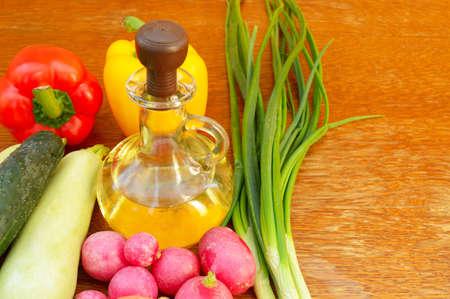 vegetable oil: fresh vegetables and a bottle of vegetable oil