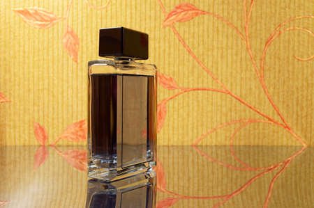 bewitch: elegant bottle of perfume on mirror surface Stock Photo