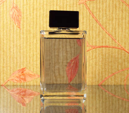 bewitch: luxury fragrant perfume vial on the mirror surface Stock Photo