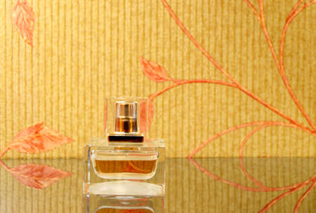 bewitch: fragrant ladies perfume vial on the mirror surface