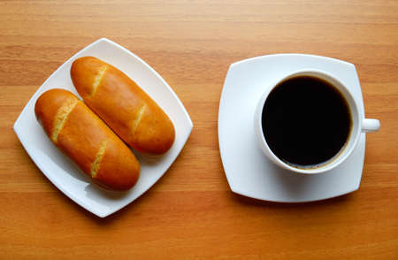 french bread rolls: French bread rolls and black coffee Stock Photo