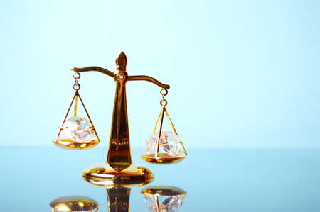 antique weight scale: Justice. Gold scales on the mirror surface Stock Photo