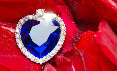 crystal heart: Crystal Heart and the dew drops on roses Stock Photo
