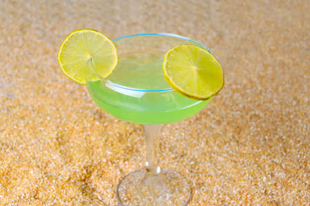 sultry: cool margarita on sultry tropical beach Stock Photo