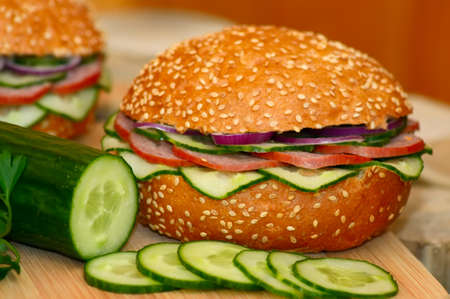 Fast food. Fresh sandwich and vegetables close-up