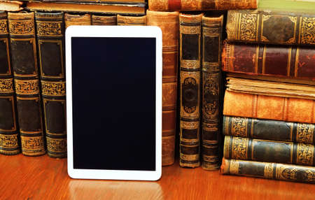 analytic: old books and modern tablet pc