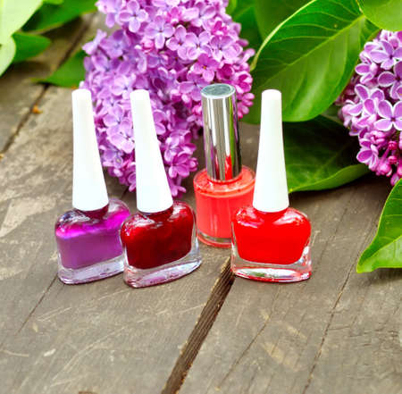 reddening: Cosmetics and the flowers of  lilac Stock Photo