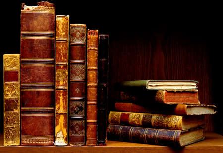 Vintage books on a dark shelf