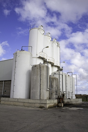 White storage in industrial enterprise, security and work silos photo