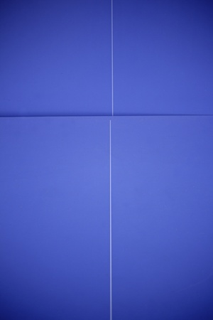 metalized: Blue wall background with shadows, lighting Stock Photo
