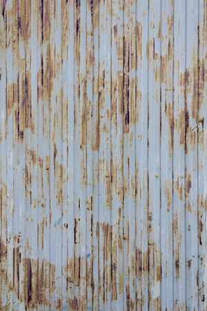 metallized: Blue Rusted door metallized at entrance to warehouse, construction